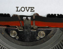 Machine à écrire écrite par AMOUR Image libre de droits