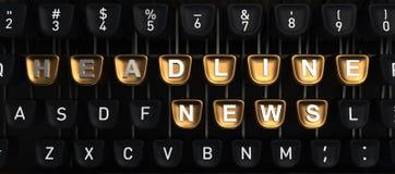Machine à écrire avec des boutons de GROS TITRES Photos stock