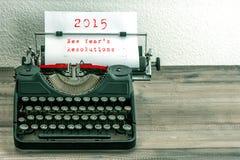 Machine à écrire avec la page de livre blanc Les résolutions d'an neuf Photographie stock