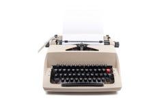 Machine à écrire avec une feuille de livre blanc Photos stock