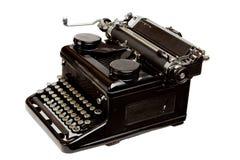 Machine à écrire de vieux type d'isolement sur le blanc photo stock