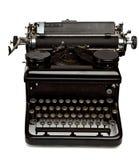 Machine à écrire de vieux type sur le blanc images stock