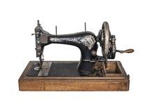 Machine à coudre de vintage sur le fond blanc Images libres de droits