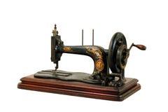 Machine à coudre de vintage sur le fond blanc Photographie stock libre de droits