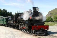 Machine à vapeur et voitures de tourisme Images libres de droits