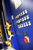 Machine. Blue industry machine with any plastic switches Stock Photo