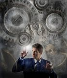 Machine. Business man moving gear of big mechanism Royalty Free Stock Photos
