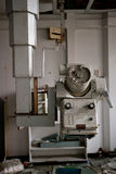 Machine in abandoned hospital Stock Image