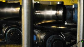 The machine aligns the metal pipe. Tube Rolling Machine At The Factory. The machine aligns the metal pipe stock video footage