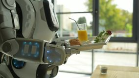 Careful robot carrying tray with breakfast stock video