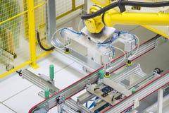 Machine arm, warehouse. Brand new machine arm, warehouse Royalty Free Stock Photos