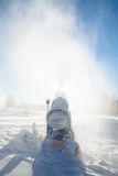 Machine for artificial snow at a ski resort Stock Image