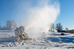 Machine for artificial snow at a ski resort Stock Images
