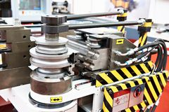Machine for bending metal. Rods and pipes royalty free stock image