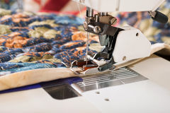 Machine binding of quilt. Stock Images