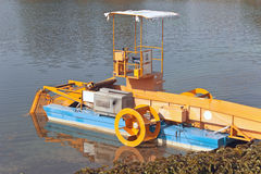 Machine boat for cleaning river plants Stock Images