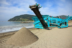 Machine cleaning the beach sand Royalty Free Stock Photos