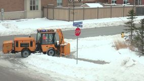Snow cleaning in the sidewalks. Machine for cleaning snow in urban pedestrian areas and sidewalks, while working stock footage