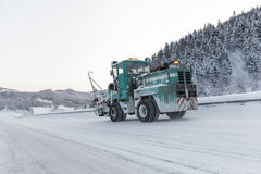 Machine cleans snow from the road Stock Photo