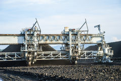 Machine in coal stock pile Stock Images