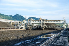 Machine in coal stock pile Stock Photography