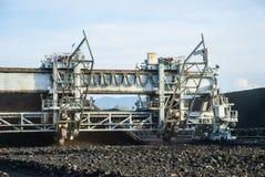 Machine in coal stock pile Stock Images