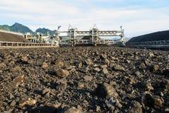 Machine in coal stock pile Stock Photo