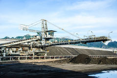 Machine in coal stock pile Royalty Free Stock Photography