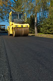 Machine for compacting asphalt Stock Images