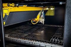 Machine for constant metal laser cutting. Metal processing close up Stock Image