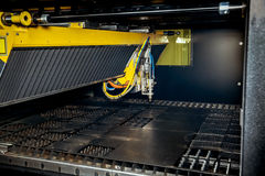 Machine for constant metal laser cutting. Metal processing close up Royalty Free Stock Images