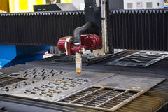 Machine for constant metal laser cutting. Metal processing close up Royalty Free Stock Photography