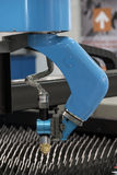 Machine for constant metal laser cutting. Metal processing close up Stock Photography