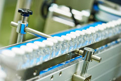Machine conveyor with glass bottles ampoules Stock Images