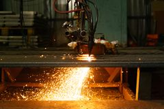 The machine cuts metal sheets with gas stock image