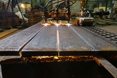 The machine cuts metal sheets with gas stock images