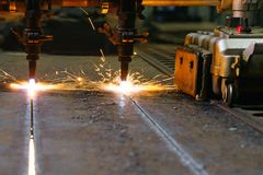The machine cuts metal sheets with gas royalty free stock photo