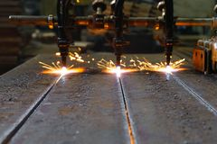 The machine cuts metal sheets with gas stock photos