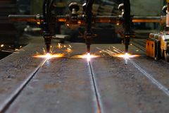 The machine cuts metal sheets with gas royalty free stock image