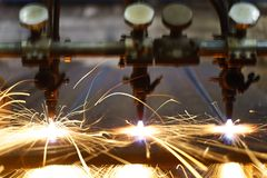 The machine cuts metal sheets with gas royalty free stock photography
