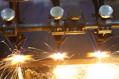 The machine cuts metal sheets with gas royalty free stock photos