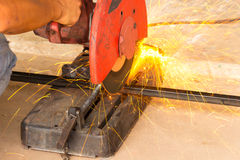 The machine is cutting sparks. Smith are cutting steel and sparks Royalty Free Stock Photo