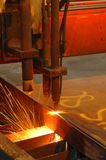 Machine cutting steel. A preprogrammed machine cutting out steel to the exact size and dimensions stock photo