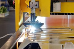 Machine cutting steel Stock Images
