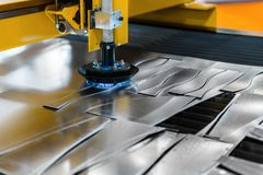 Machine cutting steel in a factory. Closeup stock photo
