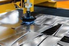 Machine cutting steel in a factory. Closeup Stock Photo