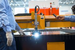 Machine cutting steel in a factory. Closeup Royalty Free Stock Images