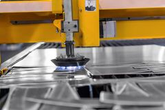 Machine cutting steel in a factory Stock Photography