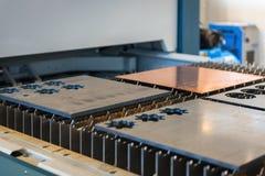 Machine cutting steel in a factory. Closeup Stock Photos