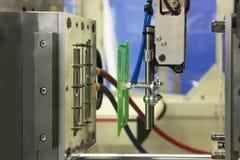 Machine de moulage par injection photographie stock